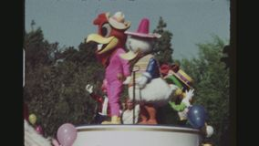 Disney Parade Seventies. USA, CALIFORNIA, LOS ANGELES, JUNE 1978. Two Shot Sequence. Daytime Lineup Of The Celebration Of Mickey Mouse`s 50th Birthday With stock video