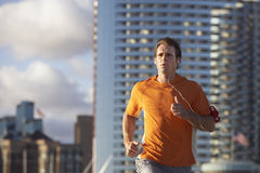 USA, California, San Diego, man jogging, listening to MP3 player strapped to arm Stock Photography