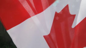 USA and Canada flags. Flag of one country superimposed upon another stock footage
