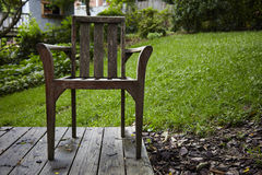 USA. Chair in a garden on wood floor Stock Images