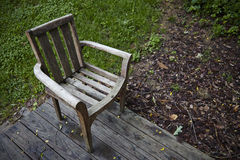 USA. Chair in a garden on wood floor Royalty Free Stock Photos