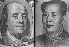 USA and China Currencies. Portraits of Benjamin Franklin and Mao Tse-Tung on USA and China bills, respectively Royalty Free Stock Photography