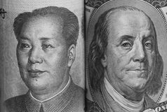 USA and China Currencies. Portraits of Benjamin Franklin and Mao Tse-Tung on USA and China bills, respectively Stock Photography