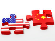 USA and China jigsaw pieces. Three dimensional illustration of Chinese and American flag on jigsaw pieces; business background isolated on white background Royalty Free Stock Photography