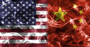 USA and China smoke flag. Isolated on a black background stock photo