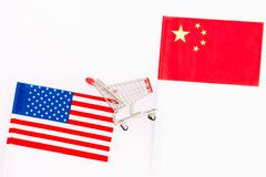 USA and China trade war. American and chinese flags near shopping chart on white background top view space for text. USA and China trade war. American and stock photos