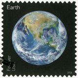 USA - CIRCA 2016: shows The Earth, series Views of Our Planets. UNITED STATES OF AMERICA - CIRCA 2016: A stamp printed in USA shows The Earth, series Views of royalty free stock photo