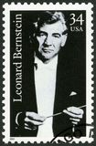 USA - CIRCA 2001: shows Leonard Bernstein 1918-1990, composer. UNITED STATES OF AMERICA - CIRCA 2001: A stamp printed in USA shows Leonard Bernstein 1918-1990 stock image