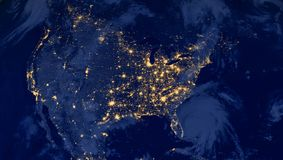 United States of America lights during night as it looks like from space. Elements of this image are furnished by NASA. USA cities lights during night as it Royalty Free Stock Image