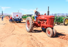USA: Classic 1950 Farmall M Tractor Performing a Power Pull. This Farmall tractor was on exhibition in Cottonwood during the 31st Annual Engine Show of the stock images