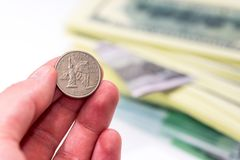 Usa coin in hand above dollar. Close up Stock Photos