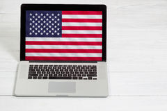 USA Computer left unsecure on white desktop Stock Photo