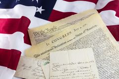 Old letters American flag historical documents. USA constitution declaration of independence patriotism vintage antique cursive hand written vintage letter faded royalty free stock image