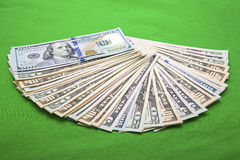 USA currency new fan pile green background. American greenback dollars are fanned out on the green felt cloth background and sybolize financial success with Royalty Free Stock Images