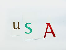 USA - Cutout Words Collage Of Mixed Magazine Letters with White Background. Caption composed with letters torn from magazines with White Background Royalty Free Stock Image