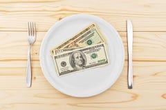 USA-Dollar gedient auf Platte als Abendessen lizenzfreies stockbild
