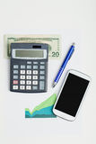 USA dollar money banknotes, calculator and mobile phone. USA dollar money banknotes and calculator, money concept, business workplace with mobile phone Stock Images