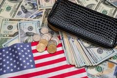 Usa dollar in purse. On usa flag Stock Photography