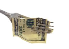 100 USA Dollars impaled on a fork - Isolated object on a white b Royalty Free Stock Images