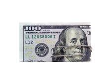 USA 100 Dollarschein mit Clip lizenzfreies stockbild