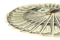 1 USA dollarsedlar som fläktas i en cirkel som isoleras ut royaltyfri bild