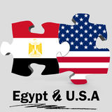 USA and Egypt flags in puzzle Royalty Free Stock Photos