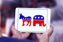 USA election political symbols. Donkey and elephant symbols of political parties in America. democratic donkey and republican elephant icons on white tablet as a stock image