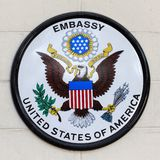 USA embassy sign on a fence in the street. The embassy is located on Wireless Road in the heart of Bangkok, Thailand. BANGKOK, THAILAND - FEBRUARY 13, 2016 : USA Royalty Free Stock Image