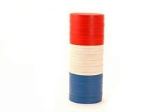 USA färbten Kasino-Pokerchips Stockfoto