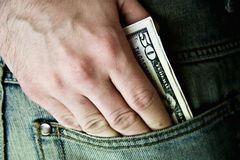 USA fifty dollars in  hip-pocket of jeans Royalty Free Stock Photo