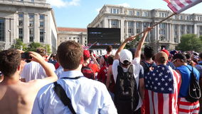 USA Finally Scores a Goal. Video of fans waiving american flags at  freedom plaza in washington dc during the world cup soccer game pitting belgium against the stock video