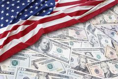 USA finance. American flag on assorted banknotes Stock Images