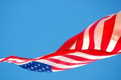 USA FLAG. Unique angle of American flag with beautiful blue sky as background Stock Photo