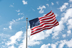 USA Flag. Against a blue clouded sky Royalty Free Stock Image
