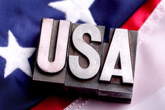 USA on flag. Letterpress blocks forming USA letters on Stars and Stripes American flag background Stock Photography