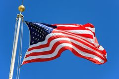 USA flag. Waving over a blue sky Stock Photography