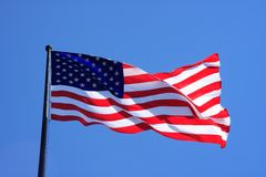 USA flag. Waving over a blue sky Royalty Free Stock Images