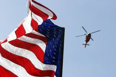 USA Flag. Helicopter flying over Flag Stock Photos