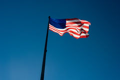 USA flag against a blue sky Royalty Free Stock Photo