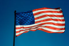 USA flag against a blue sky Royalty Free Stock Image