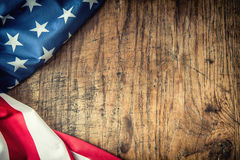 USA flag. American flag. American flag freely lying on wooden board. Close-up Studio shot. Toned Photo Royalty Free Stock Image