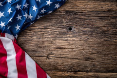 USA flag. American flag. American flag freely lying on wooden board. Close-up Studio shot. Toned Photo Stock Image