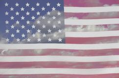 USA Flag a background of blue sky and clouds. Closeup Royalty Free Stock Photos