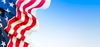 American flag on blue sky background. stock photos