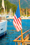 USA flag on the background of the masts of yachts. In the port royalty free stock photo