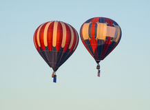 USA Flag Balloon. Two Hot Air Balloons raise the American Flag to signify the start of the balloon races Stock Photos