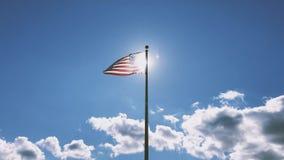 USA Flag on blue sky background. A USA American flag on a blue sky background stock footage