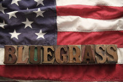 USA flag with bluegrass word Stock Photos