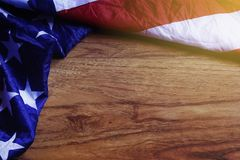 USA Flag on Brown Wooden Board. America Flag Background with Copy Space for MLK Day, President`s Day, Patriot Day, 4th of July, Independence Day Stock Photos