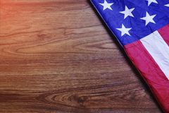 USA Flag on Brown Wooden Board Scene. USA Flag on Brown Wooden Board. America Flag Background with Copy Space for MLK Day, President`s Day, Patriot Day, 4th of Royalty Free Stock Photo